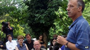 Eric Olson answers questions outside his home in Frederick, Maryland August 2002