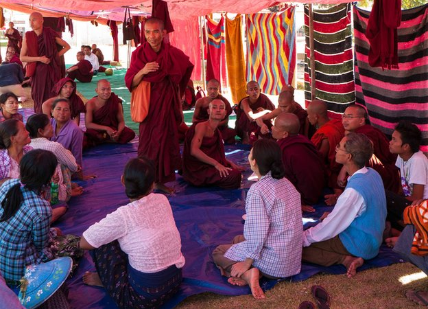 Monks and local farmers taking part in the sit-in at the pagoda inside the copper mine.