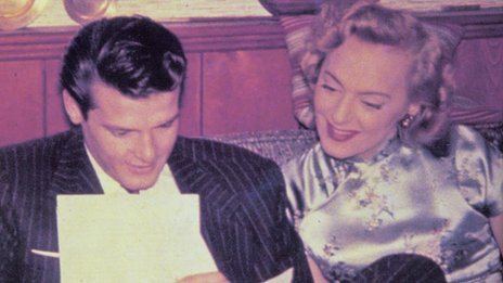 Christine Jorgensen with Roger Moore in 1960