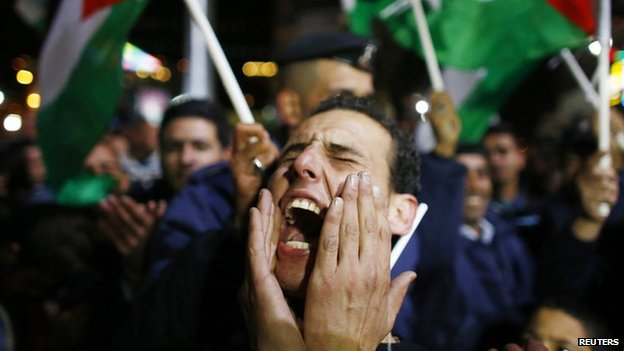 A Palestinian man shouts slogans during a rally in the West Bank city of Ramallah