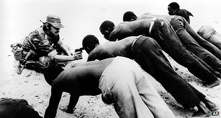 Rhodesian soldier confronts farm workers during guerrilla war
