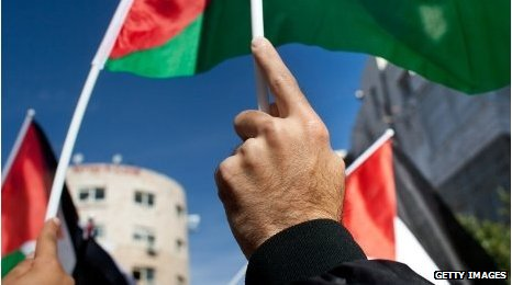 Palestinians wave flag at a recent national rally supporting the UN bid