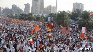 Kuwaiti opposition supporters wave flags during election protest in Kuwait City