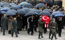 Turkish President Abdullah Gul, centre, ministers and army commanders follow a guard of honour