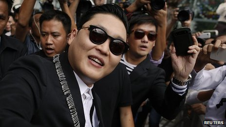 South Korean singer Psy of the dance hit &quot;Gangnam Style&quot; greets his fans ahead of his concert in Bangkok&quot;s shopping district