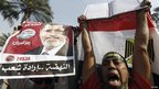 Supporters of Egyptian President Mohammed Morsi demonstrate in Cairo, 1 December