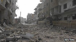 A view of buildings damaged by what activists said were missiles fired by a Syrian Air Force fighter jet loyal to Syria&quot;s President Bashar al-Assad in Daria, near Damascus, 30 November 2012