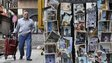 A man walks past postcards for sale at the old city of Damascus, 11 November