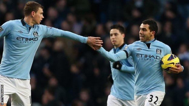 Manchester City celebrate Carlos Tevez's equaliser