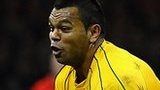 Kurtley Beale of Australia dives to take the ball during the International match between Wales and Australia