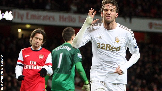 Michu celebrates his second goal against Arsenal