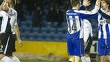 Kilmarnock edged to a 2-1 win against 10-man Queen of the South