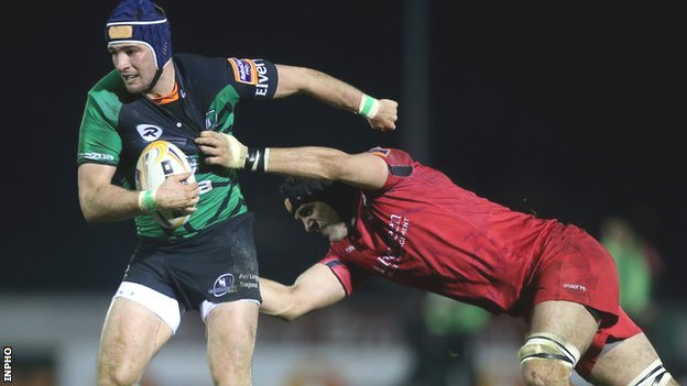 Connacht&#039;s Dave McSharry is tackled by Sean Cox of Edinburgh