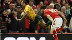Fly-half Kurtley Beale dives over for a try with the final move of the game to give Australia a 12-14 win over Wales at the Millennium Stadium