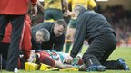 Wales full-back Leigh Halfpenny receives medical treatment after being injured while trying to stop Australia's match-winning try