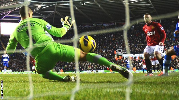 Wayne Rooney (right) scores past Adam Federici
