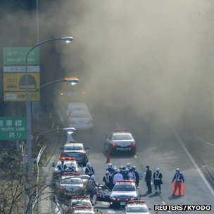 Smoke billows from the Sasago tunnel (Kyodo news agency/Reuters)