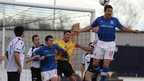 Linfield striker Matthew Tipton goes up for a header in the Premiership match away to Lisburn Distillery