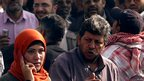 Journalist Hend Mokhtar (L) confronted by Morsi supporter - 2 December 2012