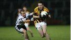 Kilcoo&#039;s Gerard McEvoy attempts to halt the run of Tony Kernan