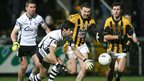 Aidan Brannigan is favourite to win this race for the ball with Crossmaglen forward Oisin McConville