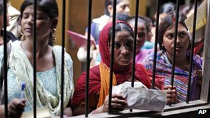 Unemployed educated Indian women wait to register themselves at the Employment Exchange Office in Allahabad, India.