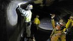 Workers inspect the structure inside the 8.5km (5.3-mile) Enasan Tunnel on the Chuo Expressway in Achimura, Nagano Prefecture, 3 Dec