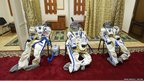 Spacesuits are seen laid out 
