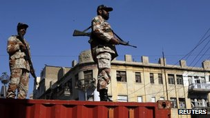 Pakistani paramilitary soldiers stand guard during an Ashura ceremony to mark the death of Hussein, the grandson of Prophet Mohammad in Karachi November 25, 2012