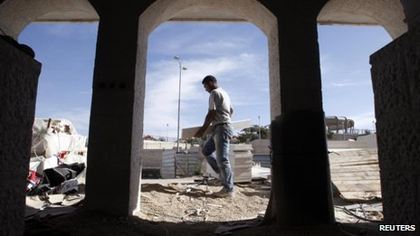A Palestinian labourer works at a construction site in the West Bank Jewish settlement of Maale Adumim
