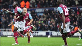 Mohamed Diame (left) wheels away in delight after scoring against Chelsea