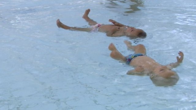 Twins William and Ellenita Trykush at their local pool in Cirencester