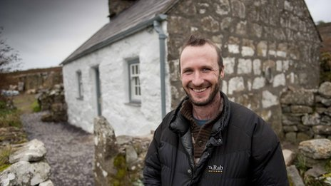 The National Trust's Andrew Godber outside the crofter's cottage