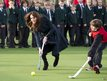 The Duchess of Cambridge, centre, plays hockey during her visit to St. Andrew's School,