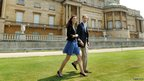 Duke of Cambridge and Catherine, Duchess of Cambridge walk hand in hand from Buckingham Palace the day after their wedding