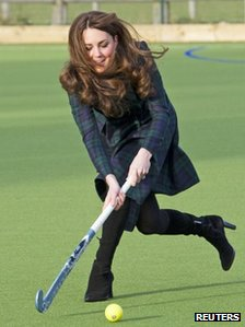 Duchess of Cambridge playing hockey on school visit on 30 November 2012