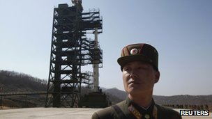 File photo: A soldier standing guard in front of a rocket sitting on a launch pad at the West Sea Satellite Launch Site, Pyongyang, 8 April 2012