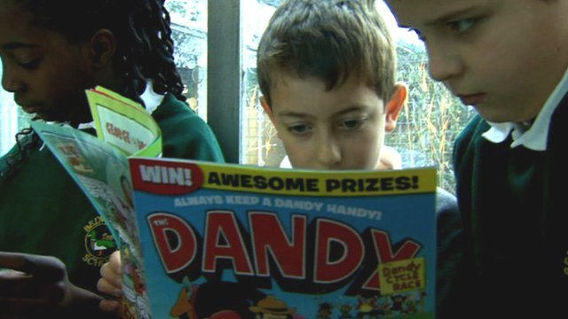 Children reading Dando