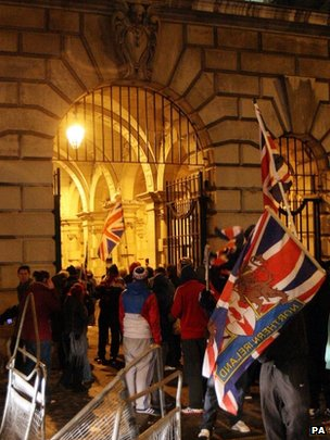 Loyalist protesters forced their way through the back gate of the City Hall