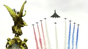 The Red Arrows and Concorde flying over the Queen Victoria memorial outside the front of Buckingham Palace, bringing celebrations for Queen Elizabeth II golden jubilee to a close in June 2002