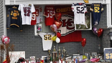 A makeshift memorial for Kansas City Chiefs football player Jovan Belcher is seen outside his mother's home in West Babylon, New York 4 December 2012
