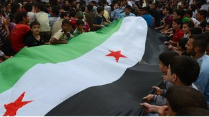 Anti-Assad protesters holding pre-Baath party era flag in Aleppo (file photo)