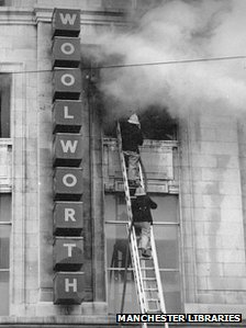 Firefighters tackle the fire at a Woolworth store in Manchester in 1979