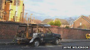 Burnt-out car on Hall Street