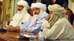 Algabass Ag Intalla (centre), leader of the Ansar Dine delegation, attends a mediation meeting with members of the Malian government and Tuareg rebels, hosted by Burkina Faso&#039;s president in Ouagadougou, 4 December 2012