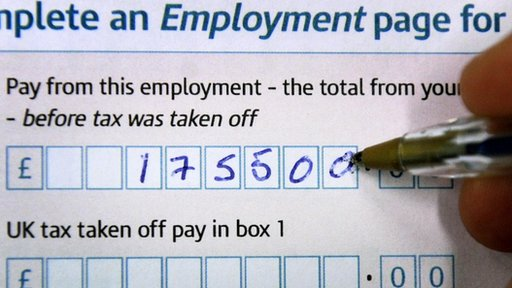 Filling out a tax return form
