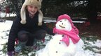 Holly Macrow builds a snowman in Chelmsford, Essex