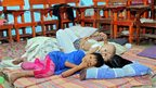 A family rest inside a classroom used as temporary shelter, after authorities evacuated residents in Butuan City on the southern island of Mindanao 