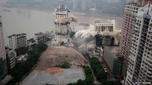 The Three Gorges Hotel and a passenger terminal are imploded in Chongqing, China