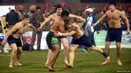 Pakistan Kabaddi player tackled by a Scotland opponent